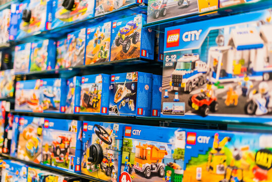 Sets of Lego construction toys displayed on store shelves