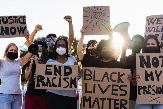 People from different culture and races protest on the street for equal rights - Demonstrators wearing face masks during black lives matter fight campaign - Focus on black woman face