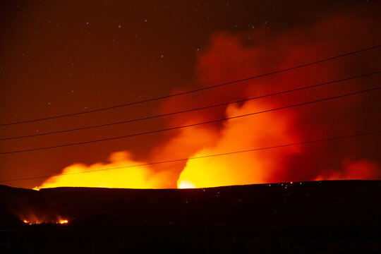 The Central Wildfire north of Phoenix Arizona burning in the night with stars seen through the smoke