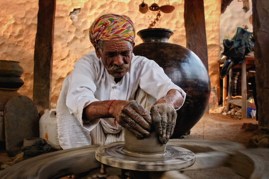 Indian potter at work. Handwork craft from Shilpagram, Udaipur, Rajasthan, India
