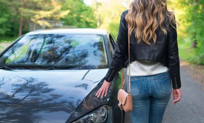 Fotobehang Ezel Female prostitute heads for the client's car.