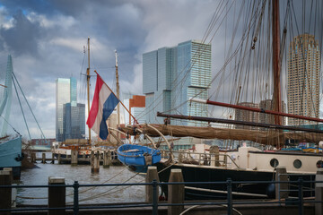 Photo sur Aluminium Rotterdam Rotterdam city skyline cityscape, Netherland (Holland). View of downtown and sailing ship with the flag from Veerhaven