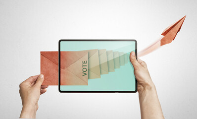 The human holds a digital tablet with paper envelope. Concept of e-voting via digital tablet.