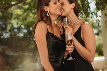 Elegantly dressed women enjoying at outdoor party