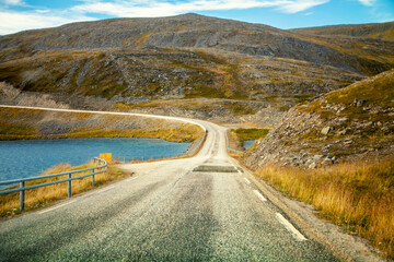 Driving a car on road in tundra. Nature of Norway. Polar circle. The way to Nordkapp