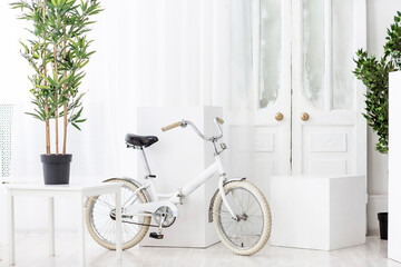 Papiers peints Velo White bicycle room and a door