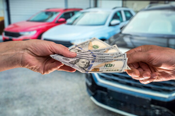 businessman gives money to rent a car for summer vacation