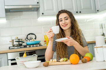 Gorgeous woman relax morning in kitchen and drinking enjoy coffee
