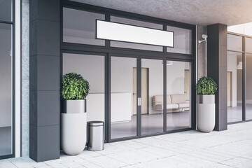 Entrance of contemporary office building with plants.