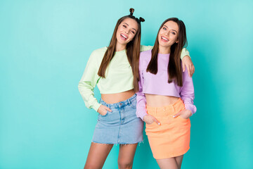 Photo of two cool funny sisters ladies best friends youth outfit hugging beaming smiling wear...