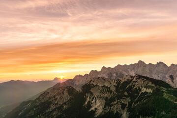 Wall Mural - Amazing sunrise in the mountains. Backlight Sunlight with beautiful sunbeams. Julian Alps, Triglav National Park, Slovenia, Mountain Slemenova, Sleme.