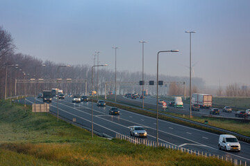 Cars on the A4 highway  near the village of Roelofarendsveen and Weteringbrug in the Netherlands.