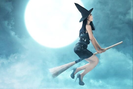 Asian witch woman with hat flying on a magic broomstick