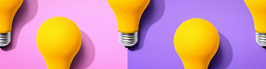 Wall Mural - Yellow light bulb pattern with shadow - flat lay