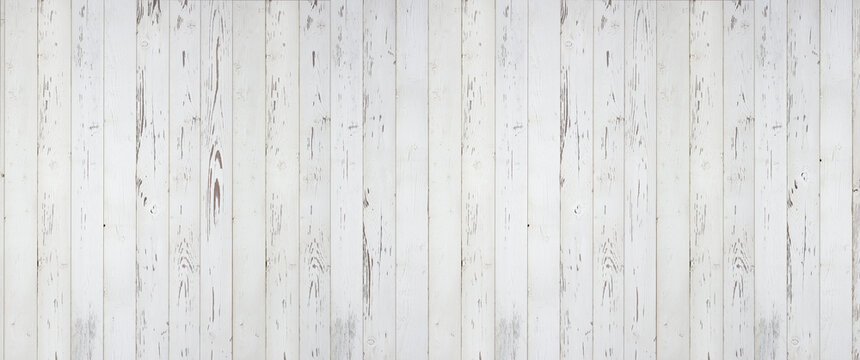 Weathered white wooden background texture. Shabby white painted wood panorama.