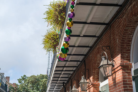 Very Large Set of Mardi Gras Beads Stretched Beneath Balcony in French Quarter of New Orleans, Louisiana, USA