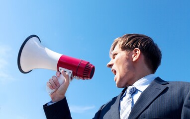 Portrait of a Businessman with Megaphone