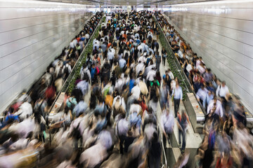 Asia, China, Hong Kong, commuters using subway during morning rush hour in underground train station in financial district