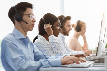 Telemarketing or customer service team providing assistance to clients at call centre office