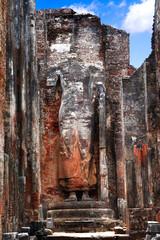 Sri Lanka travel and landmarks - ancient city of Polonnaruwa, UNESCO World Heritage Site. Buddha statue carved in the rock, Lankatilaka Vihara temple