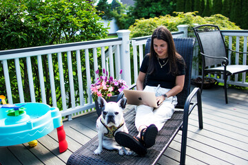 Stephanie Ellis uses her laptop at her home in Marlboro, New Jersey