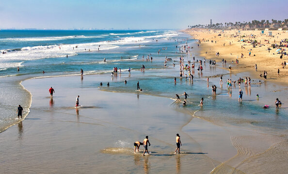 Crowded shoreline at Huntington Beach, California