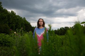 Woman in colorful dress in field 3