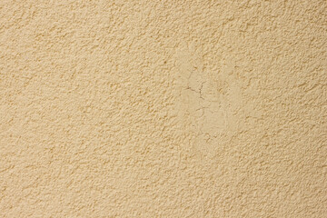 Texture of decorative plaster with a relief. Beige plaster. Close-up.