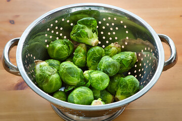 Brussel sprouts in a metal colander