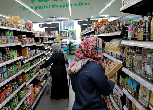 Customers wearing protective masks shopping at a Keels super market, amid concerns about the spread of the coronavirus disease (COVID-19), in Colombo