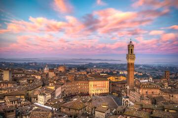 Foto op Canvas Lichtroze Siena cityscape at sunset.