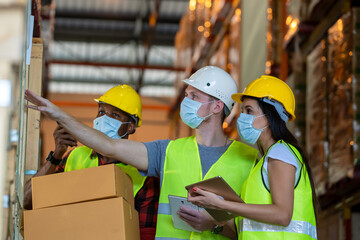 Group warehouse workers wearing protective mask to Protect Against Covid-19 working together at warehouse,Coronavirus has turned into a global emergency.