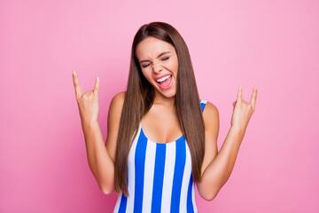 Photo of pretty crazy lady long straight hairdo bronze body skin show hands horns rocker enjoy...