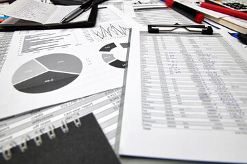 Top view of office employee's desk - work with financial reports, analysis and accounting, tables...