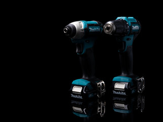 CHONBURI, THAILAND-MAY 24, 2020 : Makita codless driver drill isolated on dark background. Makita tools. Single sleeve keyless driver drill chuck for easy bit installation/removal. Technician tools.
