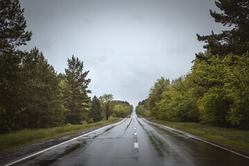 Wet country road. Rainy weather.