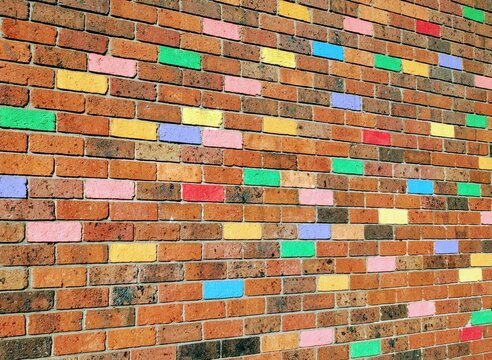 Brick wall with colorful painted bricks