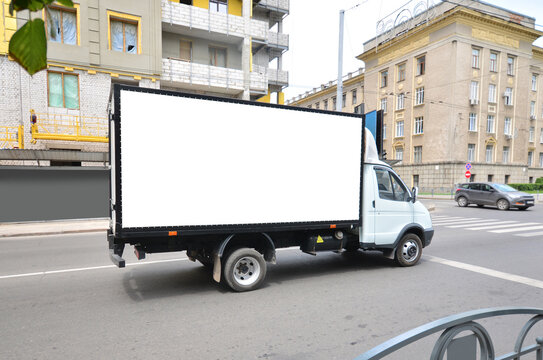 Commercial truck with empty mockup banner on a van