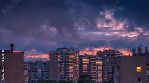 Fotobehang Epic dramatic colorful storm rainy clouds passing over city skyline as sunset sky reflects in windows of tall apartment buildings in urban area of Yekaterinburg, Russia. Timelapse, 4K UHD.