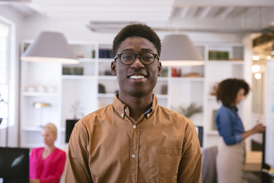 Happy young African American portrait in workspace