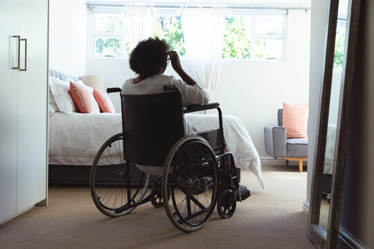 Senior African American woman on wheelchair  at home during quarantine lock down for coronavirus cov