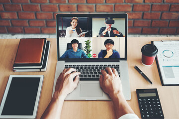 Asian man working from home use Smart working and video conference online meeting with Asian team...