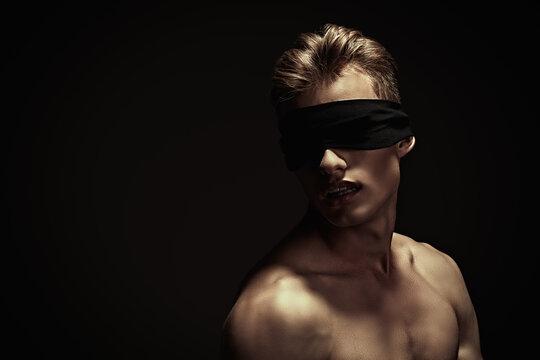 naked guy with blindfold