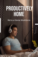 bi-racial man listening music in headphones and using laptop near productively home, were a home...