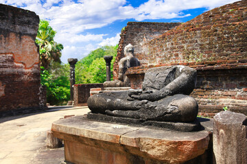Sri Lanka travel and landmarks - ancient city of Polonnaruwa, UNESCO World Heritage Site. Buddha statue' ruins in Vatadage temple