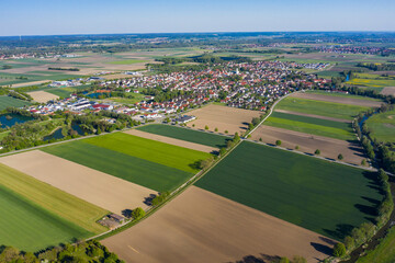 Aerial view of the village Nordendorf in Germany, Bavaria on a sunny spring day during the coronavirus lockdown.