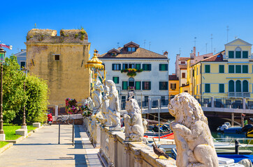 Refugium Peccatorum monuments near marina water canal in historical centre of Chioggia town, blue sky background in summer day, Veneto Region, Northern Italy Fotomurales