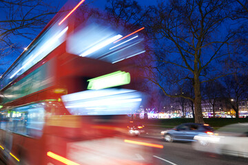 London bus in the traffic at night