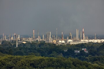 Oil refinery buildings with big silos and chimneys