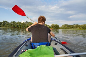 Kayaking on a river in an inflatable kayak boat